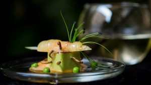 An appetizer of'Petit pois carre et son ecume de Carottes, vers de farine' - peas, carrots and worms - prepared by French chef David Faure in his Michelin-rated restaurant 'Aphrodite' in Nice, France.