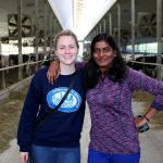 Two graduate students, who have graduate opportunities with Arrell Food Institute and Food from Thought, stand in a dairy barn