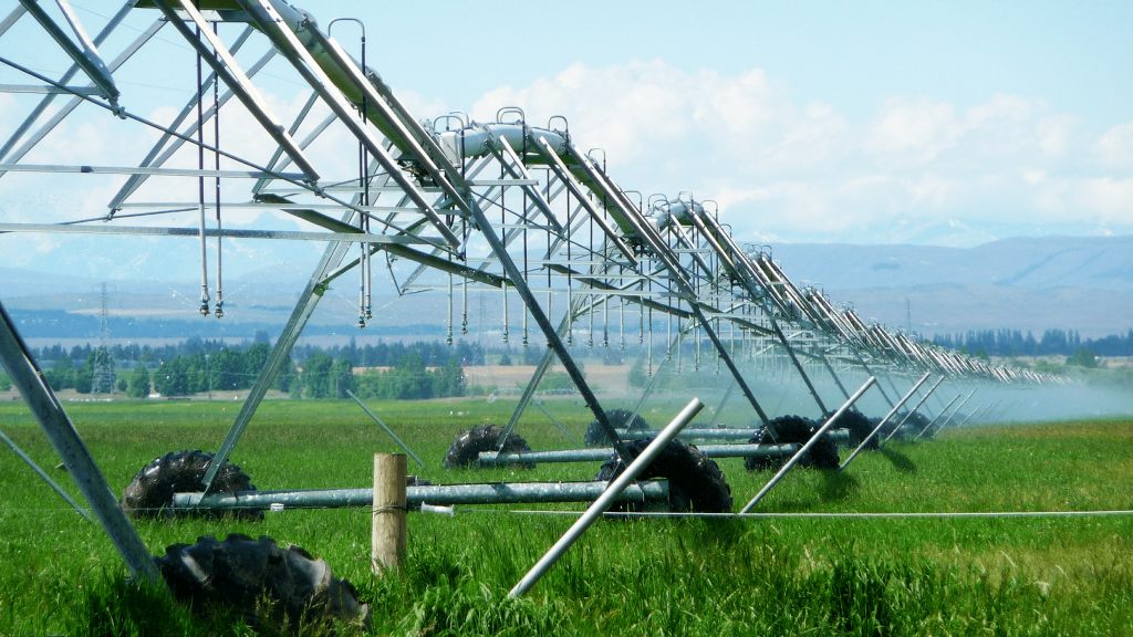 An irrigation system spraying water in a pasture