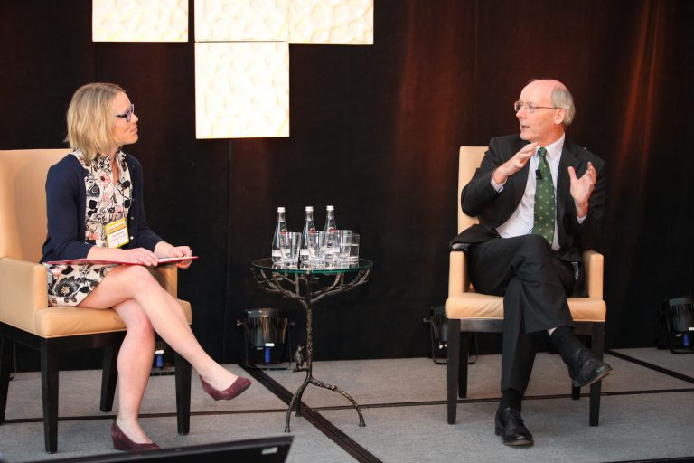 Jess Haines speaks to Dr. Charles Godfray, both seated on stage, at the Arrell Food Summit
