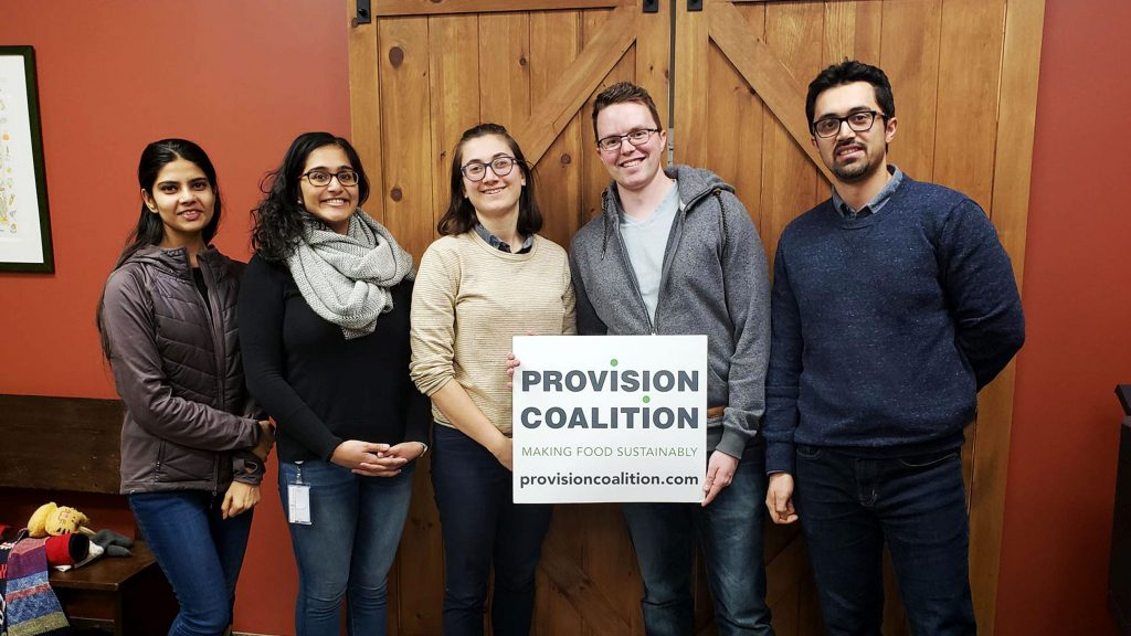 Sugandha Raj, Praveena Thirunathan, Simone Weinstein (Provision Coalition Project Coordinator), Jared Stoochnoff, and Seyed Ahmadi pose with a Provision Coalition sign.