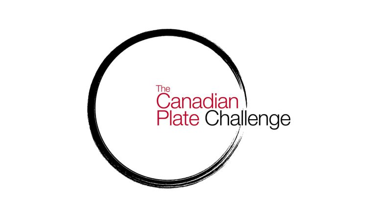 "A painted black circle with the word ""The Canadian Plate Challenge"""