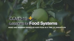 """Apple on a tree, with overlaid text reading """"COVID-19 + Lessons for Food Systems"""""""