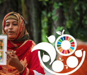 Woman holds a diagram. Image layered with SDG graphics