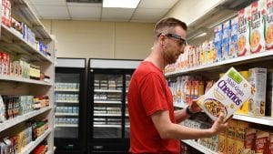 Simon wears glasses that track his eye movements in a grocery store lab